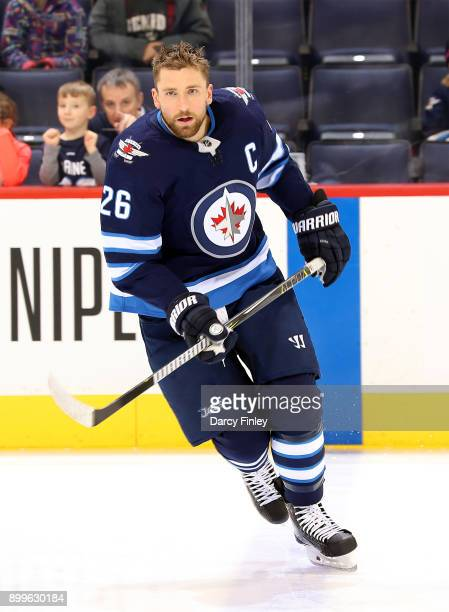 Blake Wheeler of the Winnipeg Jets takes part in the pregame warm up prior to NHL action against the New York Islanders at the Bell MTS Place on...