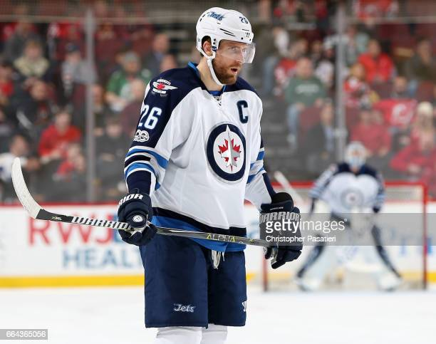 Blake Wheeler of the Winnipeg Jets waits for a face off during the first period against the New Jersey Devils on March 28 2017 at the Prudential...
