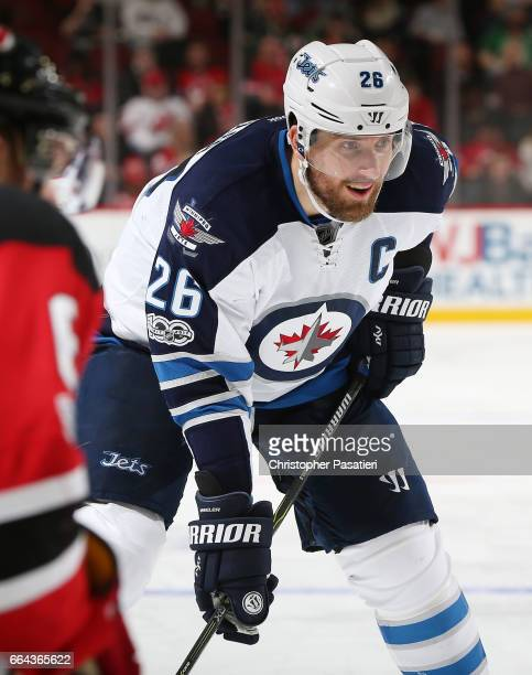 Blake Wheeler of the Winnipeg Jets waits for a face off during the game against the New Jersey Devils on March 28 2017 at the Prudential Center in...