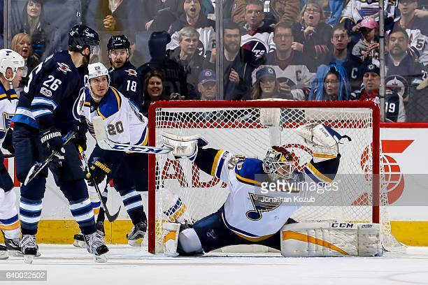 Blake Wheeler of the Winnipeg Jets watches as goaltender Pheonix Copley of the St Louis Blues makes a glove save during third period action at the...