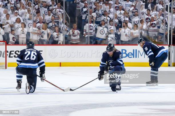 Blake Wheeler Patrik Laine and Bryan Little of the Winnipeg Jets react following the final buzzer in a 21 loss against the Vegas Golden Knights in...