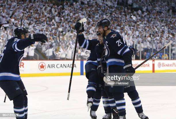 Blake Wheeler, Paul Stastny and Jacob Trouba of the Winnipeg Jets celebrate Trouba's goal against the Nashville Predators in Game Three of the...