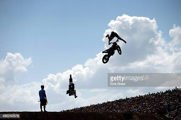 Blake Williams races against Mat Rebeaud in the quarterfinals of the Moto X Speed Style competition during the X Games Austin at Circuit of The...