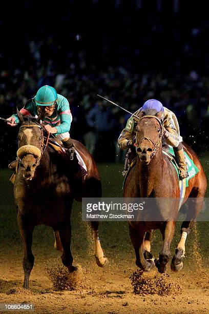 Blame ridden by Garrett Gomez crosses the finish line ahead of Zenyatta ridden by Mike Smith in the Classic during the Breeders' Cup World...