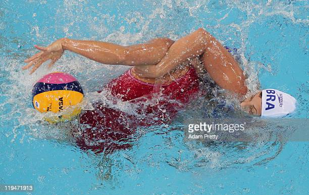 Blanc Gil Sorli of Spain tangles with Luiza Carvalho of Brazil in the Women's Water Polo first preliminary round match between Brazil and Spain...