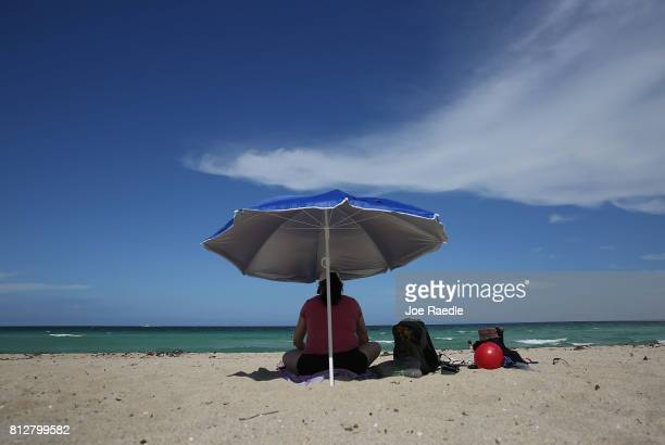 Blanca Alende enjoys Haulover Beach where a rare shark attack occured on Sunday afternoon on July 11 2017 in Sunny Isles Florida MiamiDade Fire...