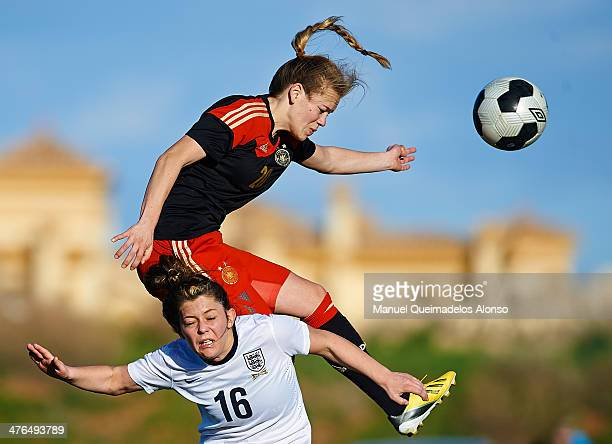 Blanca Bragg of England competes for the ball with Margarita Gidion of Germany during the U23 friendly match between England and Germany at la Manga...