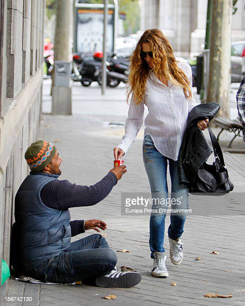 Blanca Cuesta gives alms to a beggar on November 19 2012 in Madrid Spain