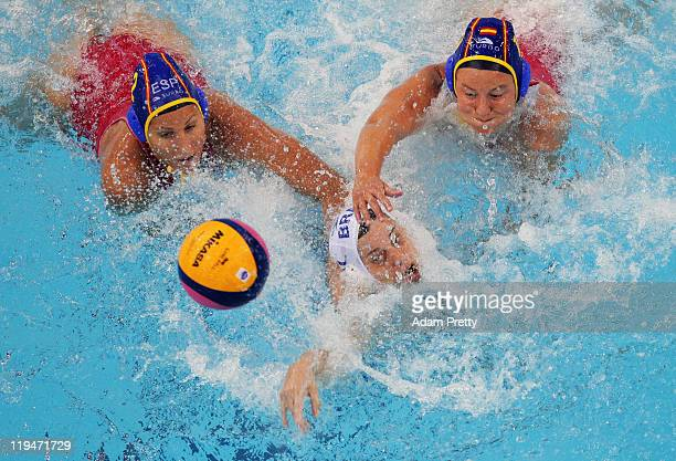 Blanca Gil Sorli and Ona Meseguer Flaque of Spain challenge Maria Pena Carrasco of Brazil in the Women's Water Polo first preliminary round match...