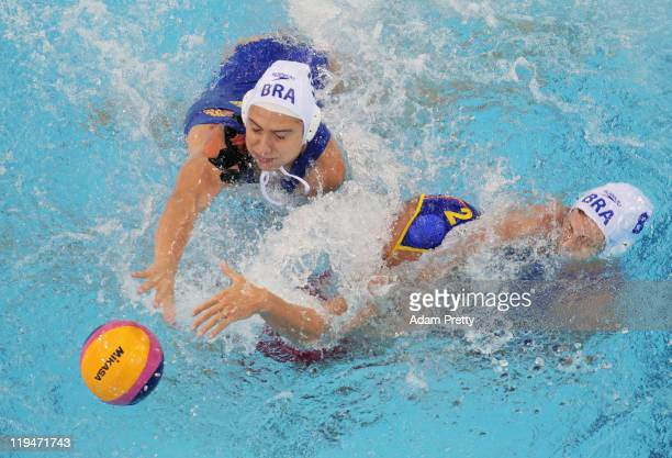 Blanca Gil Sorli of Spain battles with Marina Zablith and Luiza Carvalho of Brazil competes in the Women's Water Polo first preliminary round match...
