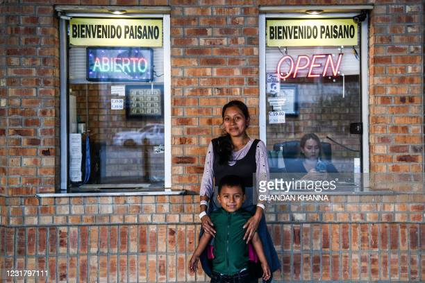 Blanca Lopez, a migrant form Guatemala, poses with her son Alexis Gomez as they wait for a bus at a station near the Gateway International Bridge,...
