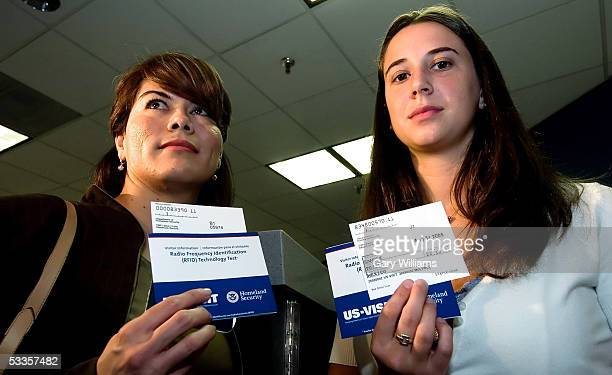 Blanca Maristal and Breanna Hackenberry both US goverment employees display new visa cards that they tested for the news media by crossing the border...