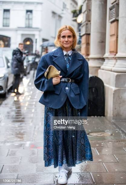 Blanca Miro is seen wearing belted navy blazer skirt with snake print outside Emilia Wickstead during London Fashion Week February 2020 on February...