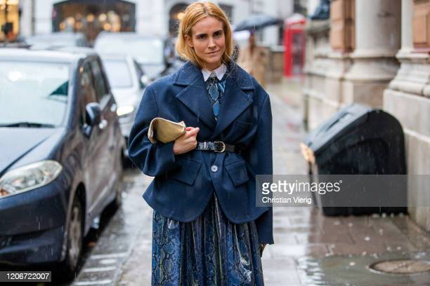Blanca Miro is seen wearing belted navy blazer, skirt with snake print outside Emilia Wickstead during London Fashion Week February 2020 on February...