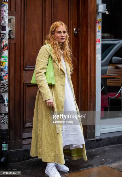Blanca Miro is seen wearing yellow corduroy coat green bag outside Marques Almeida during London Fashion Week February 2020 on February 15 2020 in...