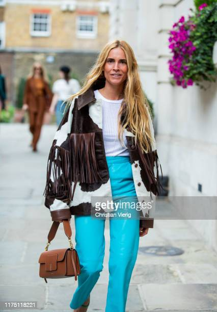 Blanca Miro Scrimieri seen wearing jacket with fringes and cow print turqouis pants outside Erdem during London Fashion Week September 2019 on...