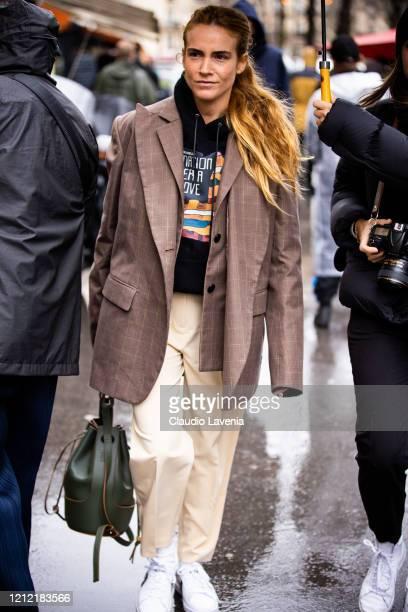 Blanca Miro Scrimieri, wearing a black printed sweatshirt, brown checked blazer, cream pants and green bag, is seen outside Sacai, during Paris...