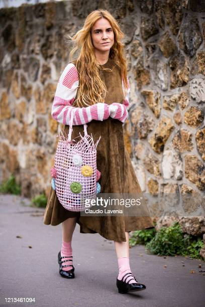 Blanca Miro Scrimieri, wearing a red and cream sweater, brown dress, pink decorated bag, pink socks and black shoes, is seen outside Loewe, during...
