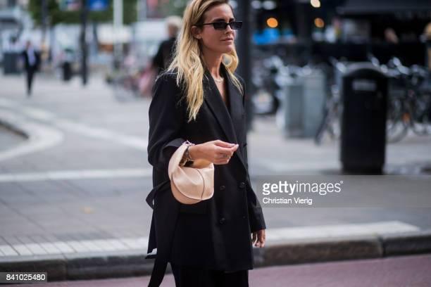 Blanca Miro Scrimieri wearing black coat and wide leg pants outside Rodebjer on August 30 2017 in Stockholm Sweden