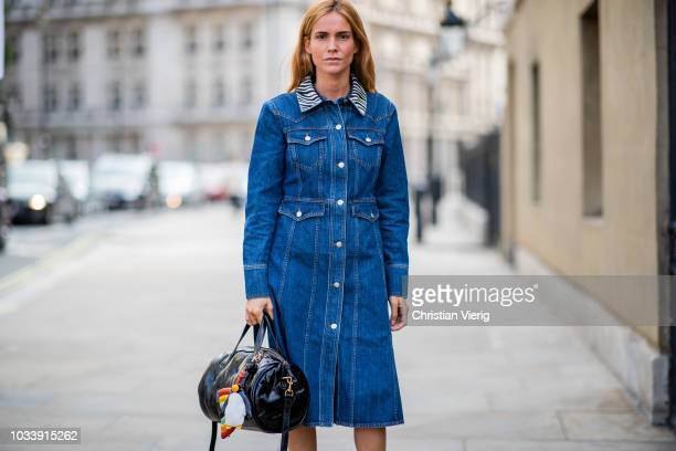 Blanca Miro Scrimieri wearing denim dress is seen outside Anya Hindmarch during London Fashion Week September 2018 on September 15 2018 in London...