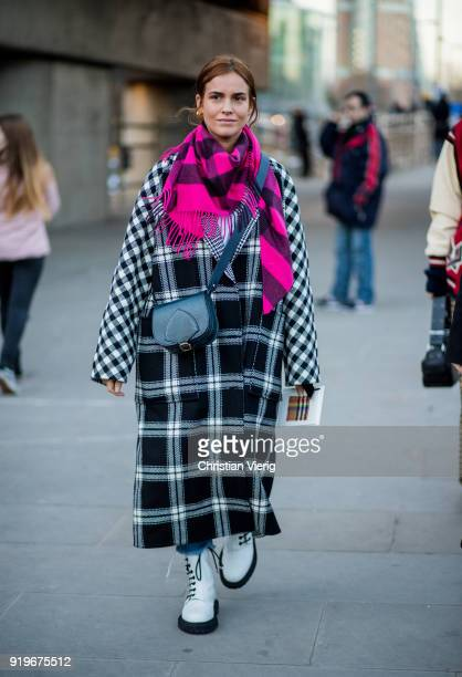 Blanca Miro Scrimieri wearing plaid coat pink plaid scarf seen outside Burberry during London Fashion Week February 2018 on February 17 2018 in...