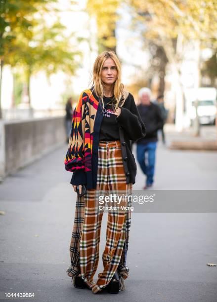 Blanca Miro Scrimieri wearing plaid pants two tone cardigan is seen outside Sacai during Paris Fashion Week Womenswear Spring/Summer 2019 on October...