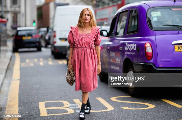 Blanca Miro Scrimieri wearing red pink dress bag with leopard animal print is seen outside Natasha Zinko during London Fashion Week September 2018 on...