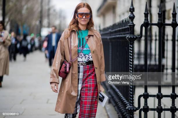 Blanca Miro Scrimieri wearing tartan pants trench coat sunglasses Chanel bag seen outside Delpozo during London Fashion Week February 2018 on...