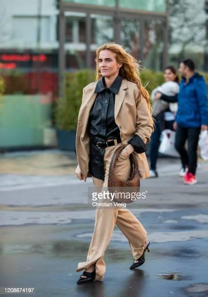 Blanca Miro seen wearing camel blazer and pants, brown bag with snake print outside Koche during Paris Fashion Week - Womenswear Fall/Winter...