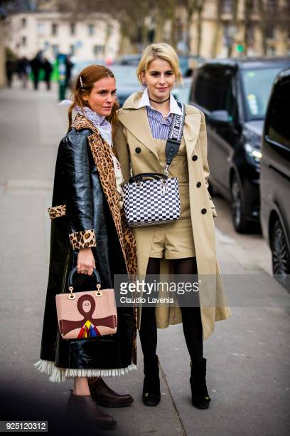 Blanca Miro wearing a long black trench with animalier collar and a colored Dior bag and Caroline Daur wearing a beige trench and a Dior checked bag...