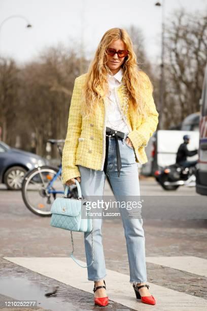 Blanca Miro wearing Chanel yellow tweed jacket, blue Chanel bag outside Paris Fashion Week Womenswear Fall/Winter 2020/2021 Day Nine on March 03,...