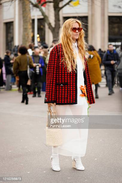 Blanca Miro wearing Miu Miu red and black check jacket net bag white socks white wedge heels and white skirt outside the Miu Miu show during Paris...