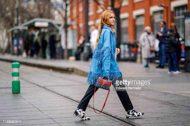 Blanca Miro wears a blue fringed jacket, a red and multicolor tweed bag, black pants, black and white shoes with animal print, outside Nina Ricci,...