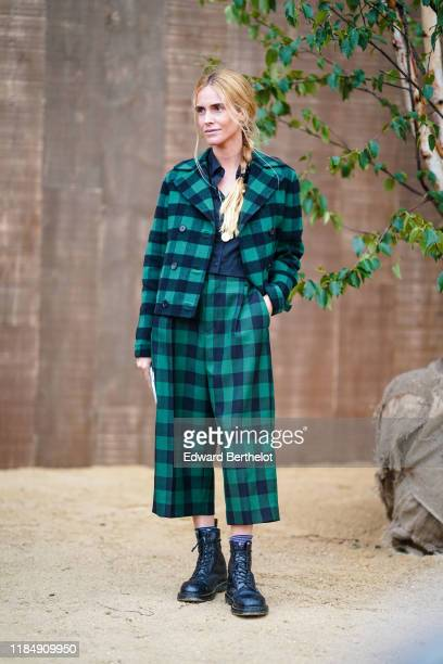 Blanca Miro wears a green and black checked jacket flared cropped pants black leather shoes outside Dior during Paris Fashion Week Womenswear Spring...