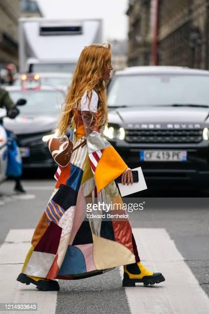 Blanca Miro wears a multicolor patchwork long dress yellow boots a Prada brown leather bag outside Nina Ricci during Paris Fashion Week Womenswear...