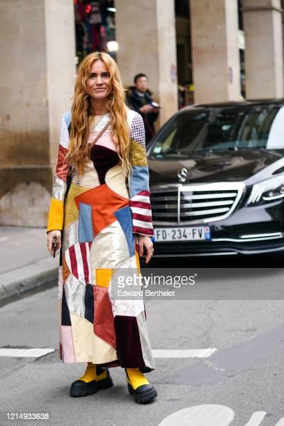 Blanca Miro wears a multicolor patchwork long dress, yellow boots, outside Nina Ricci, during Paris Fashion Week - Womenswear Fall/Winter 2020/2021,...