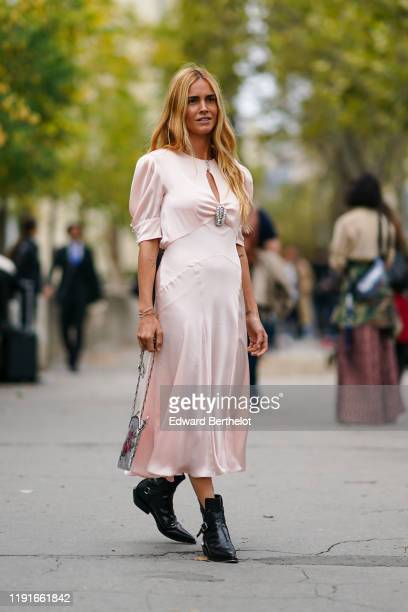 Blanca Miro wears a pale pink lustrous silky dress with a bejeweled part black leather pointy shoes outside Paco Rabanne during Paris Fashion Week...