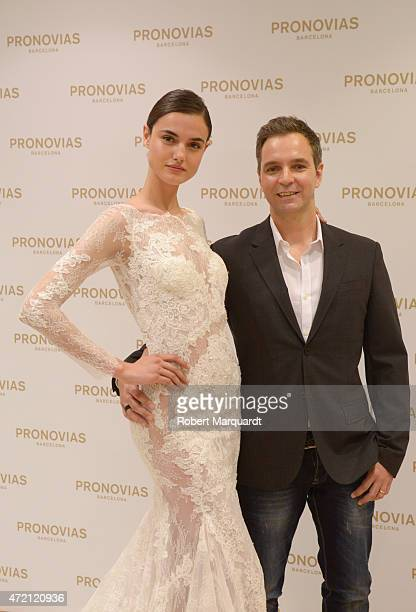 Blanca Padilla and Herve Moreau pose during a press presentation for the Atelier Pronovias 2016 collection on May 4 2015 in Barcelona Spain
