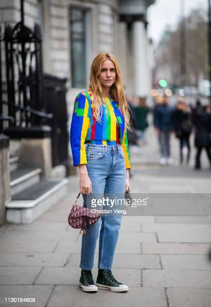 Blanca Padilla is seen wearing denim jeans multi colored top Dior saddle bag outside Halpern during London Fashion Week February 2019 on February 16...