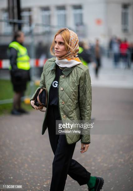 Blanca Padilla is seen wearing head scarf green puffer jacket outside Burberry during London Fashion Week February 2019 on February 17 2019 in London...