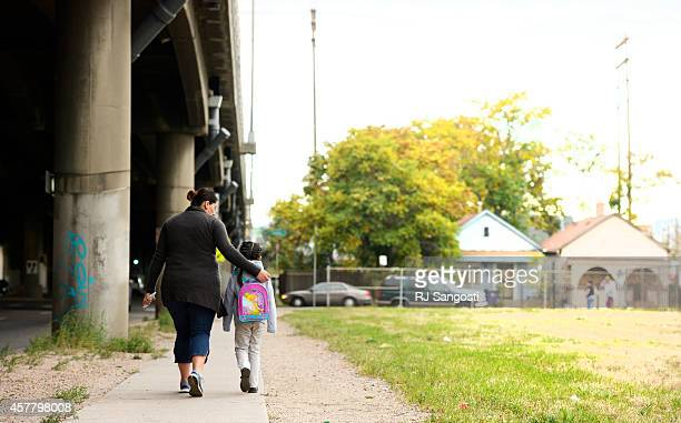 Blanca Sanchez walks her daughter Ileana Sanchez to Swansea Elementary October 24 2014 The school just north of Interstate 70 and is in the middle of...