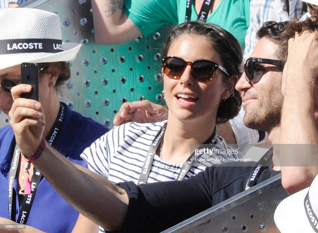 Blanca Suarez and Miguel Angel Silvestre attend the Mutua Madrid Open tennis tournament at La Caja Magica on May 12, 2013 in Madrid, Spain.