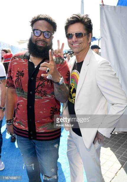 Blanco Brown and John Stamos attend FOX's Teen Choice Awards 2019 on August 11 2019 in Hermosa Beach California