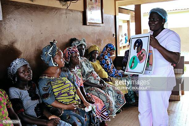 Blandine Mekpo a midwife at a maternity ward provides information about AIDS to pregnant women in Bohicon in southern Benin on November 29 2016 / AFP...