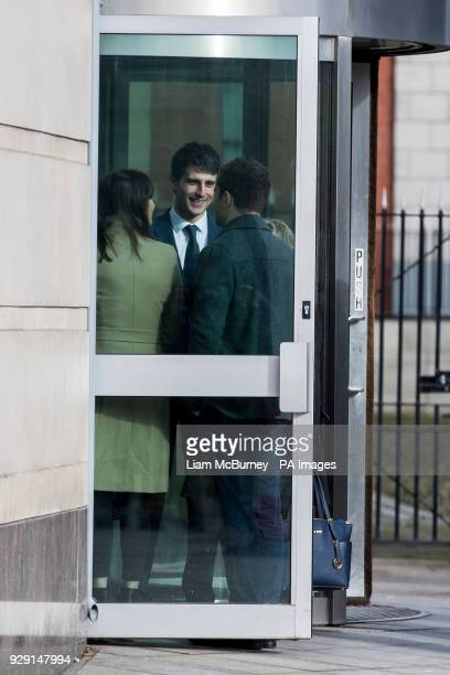 Blane McIlroy interacts with Ireland and Ulster rugby player Paddy Jackson as they meet while queuing to enter Belfast Crown Court where Mr McIlroy...