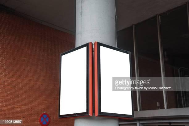 blank advertisement panel at building entrance - twee objecten stockfoto's en -beelden
