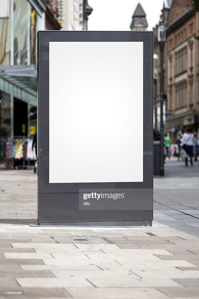 Blank advertising billboard in the city center : Stock Photo