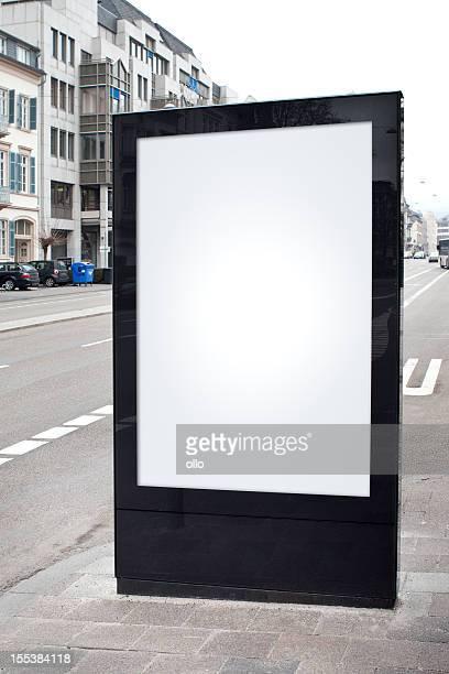 Blank advertising billboard on city street - copy space