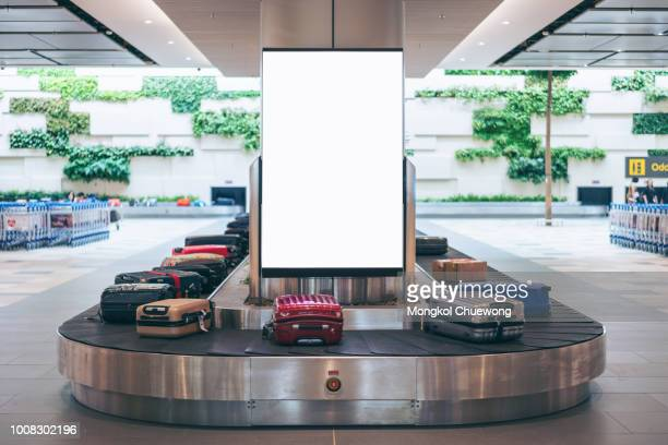 blank advertising billboard with baggage and luggage in the international airport - template stock pictures, royalty-free photos & images