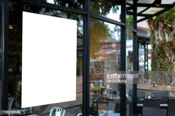 blank banner on window glass template.promotion display in front of cafe and restaurant mock up. - window stock pictures, royalty-free photos & images